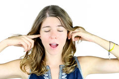 Blocking her ears Stock Images
