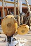 Blocks. Sailing pulleys and ropens of an ancient sailboat royalty free stock image