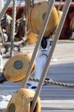 Blocks. Sailing pulleys and ropes of a vintage sailboat stock photo