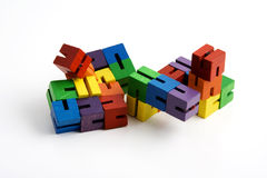 Blocks. Wooden blocks on string to help children focus their attention while studying in class teachers give to students that have learning disorders like adhd Royalty Free Stock Photos