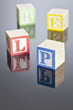 Blocks. Childrens toy blocks spelling out various words on a reflective surface stock images