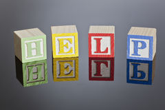 Blocks. Childrens toy blocks spelling out various words on a reflective surface royalty free stock photos