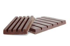 Blocks of dark chocolate on white backg Royalty Free Stock Photos