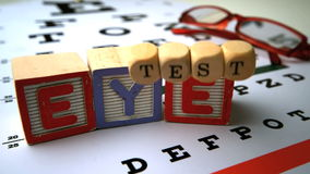 Blocks and dice spelling eye test falling onto eye test Stock Photography