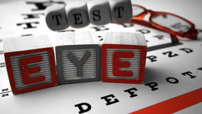 Blocks and dice spelling out eye test falling onto eye test Royalty Free Stock Photo