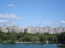 Blocks of flats on lakes shore Stock Image