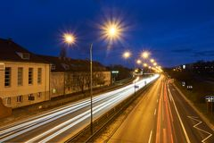 Blocks of flats and a two-lane street during a night. In Poznan royalty free stock photo