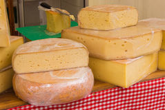 Blocks of fresh yellow cheese for sale on stall Royalty Free Stock Photos