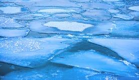 Blocks of ice on the coast of the frozen sea Stock Photos