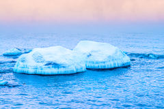 Blocks of ice on the coast of the frozen sea Royalty Free Stock Photo