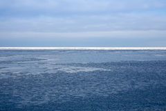 Blocks of ice on the coast of the frozen sea Stock Photo
