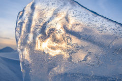 Blocks of ice gleaming in the sun, snow, frost. Frozen water surface Stock Images