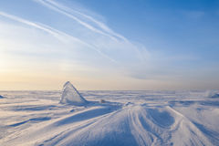 Blocks of ice gleaming in the sun, snow, frost. Frozen water surface Royalty Free Stock Photo