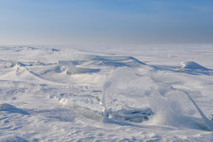 Blocks of ice gleaming in the sun, snow, frost. Frozen water surface Stock Photo
