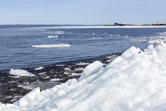 Blocks of ice and snow in lake port Stock Photo
