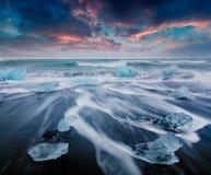 Blocks of ice washed by the waves on Jokulsarlon beach Stock Photo