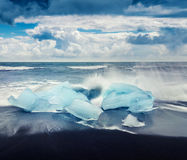 Blocks of ice washed by the waves on Jokulsarlon beach. Stock Photography