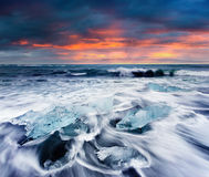 Blocks of ice washed by the waves on Jokulsarlon beach. Royalty Free Stock Photo
