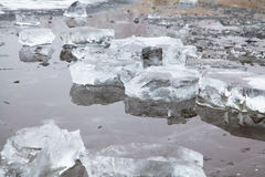 Blocks of ice on a winter frozen river Stock Photos