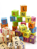 Blocks with letters and numbers. Wooden blocks with letters and numbers  on white background Stock Photography