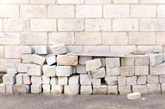 Blocks of lightweight cellular concrete. Blocks of lightweight cellular concrete on the brick wall background. The process of construction and insulation wall Royalty Free Stock Photography