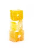 Blocks of orange. lemon and grapefruit. On a white background Stock Images