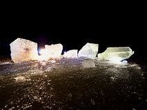 Blocks of shining ice and snow on the shore. The floes and crushed ice stock image