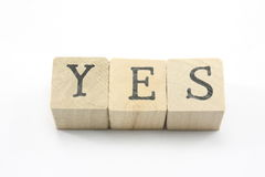 Blocks spell Yes. Home made blocks spell out the word Yes Royalty Free Stock Images