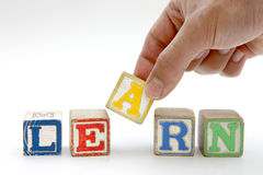 Blocks spelling 'learn'. Childrens toy blocks spelling 'learn Royalty Free Stock Images