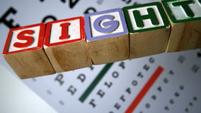 Blocks spelling out sight falling on eye test stock video