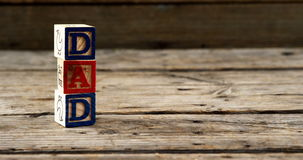 Blocks with text dad on wooden plank stock video footage