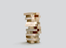 Blocks wood game  jenga  on gray background. Stock Images