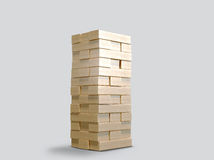 Blocks wood game  jenga  on gray background. Stock Photos