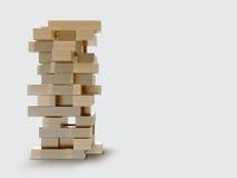Blocks wood game  jenga  on gray background. Stock Image