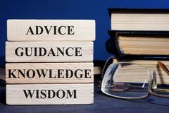 Blocks with words Advice Guidance Wisdom Knowledge. Wooden blocks with words Advice Guidance Wisdom Knowledge royalty free stock photo