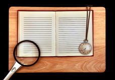 Blocnote en Loupe en Horloge Royalty-vrije Stock Foto's