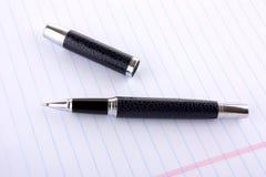 Blocnote met een pen royalty-vrije stock foto