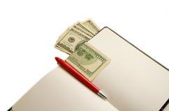 Blocnote met geld en creditcard Stock Foto's