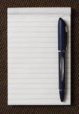 Blocnote met pen. Stock Foto's