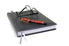 Blocnote met Pen en Vlekken Stock Afbeelding