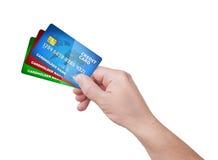 Bloco da terra arrendada da mão do cartão de crédito Foto de Stock