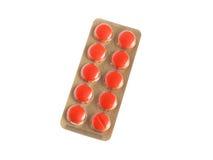 Bloco de bolha dos comprimidos vermelhos isolados no branco Imagem de Stock Royalty Free