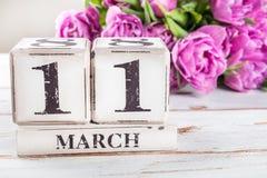 Bloco de madeira com data de dia das mães, o 11 de março fotografia de stock royalty free
