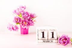 Bloco de madeira com data de dia das mães, o 11 de março imagem de stock royalty free