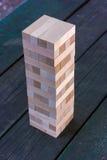 Bloco de madeira do jogo que está na tabela Imagens de Stock Royalty Free