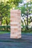 Bloco de madeira do jogo que está na tabela Fotografia de Stock Royalty Free