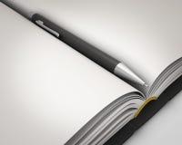 Bloco de notas com close-up da pena Imagem de Stock