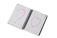 Bloco de notas espiral com o trajeto no coração e na pergunta Foto de Stock Royalty Free