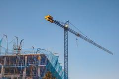 Bloco na construção e no guindaste Imagens de Stock
