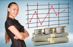 Blocos da mulher de negócios e do dólar com casas de fileira Fotografia de Stock